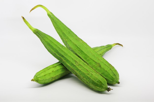 Ripe green chinese okra fruits isolated on white