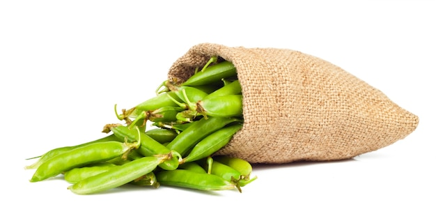 Ripe green peas in the shell isolated
