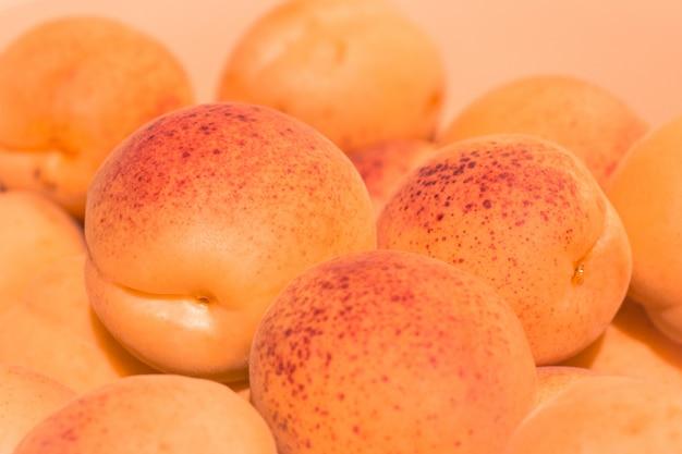 Ripe juicy apricots close up