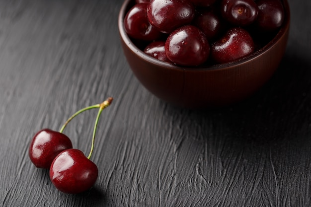 Ripe and juicy cherry berries on black