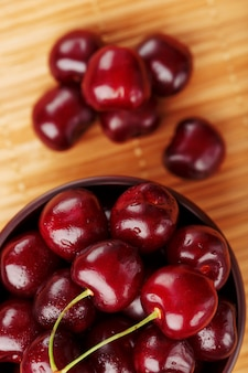 Ripe and juicy cherry berries on wood