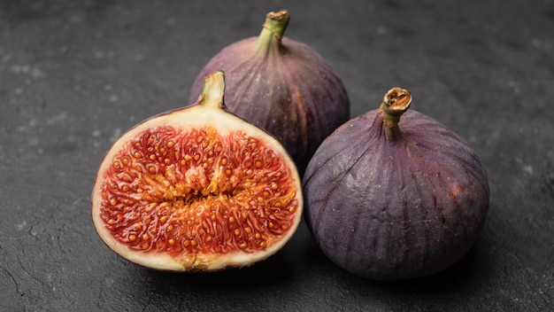 Ripe juicy figs cut in half style.