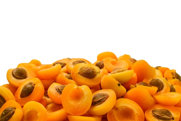 Ripe juicy orange apricots slices isolated on white background. space for text or design.