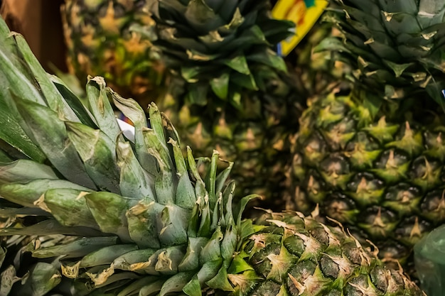 Ripe juicy pineapples in the store. tropical fruits for diet food.