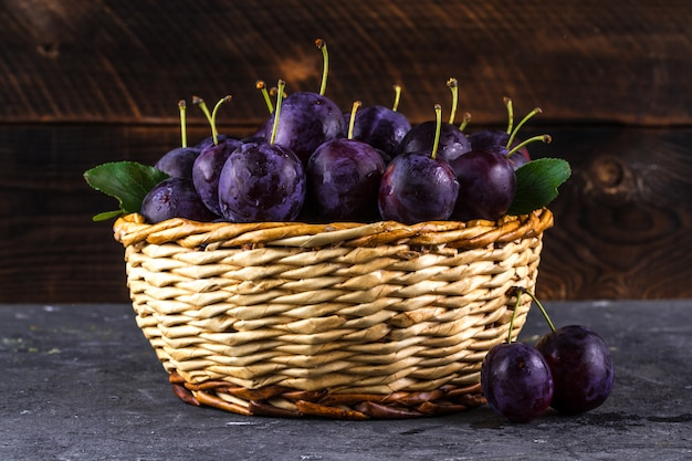 Ripe, juicy plums in a basket