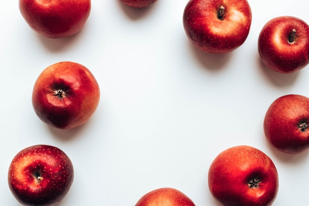 Ripe juicy red rayal gala apples on grey backgroung top view autumn composition
