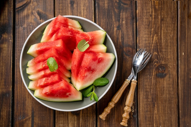 Ripe and juicy seedless sliced watermelon on a plate