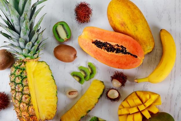 Ripe juicy tropical summer seasonal fruits mango papaya pineapple kiwi bananas