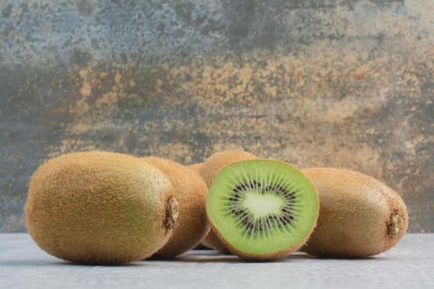 Ripe kiwi fruits on stone table. high quality photo