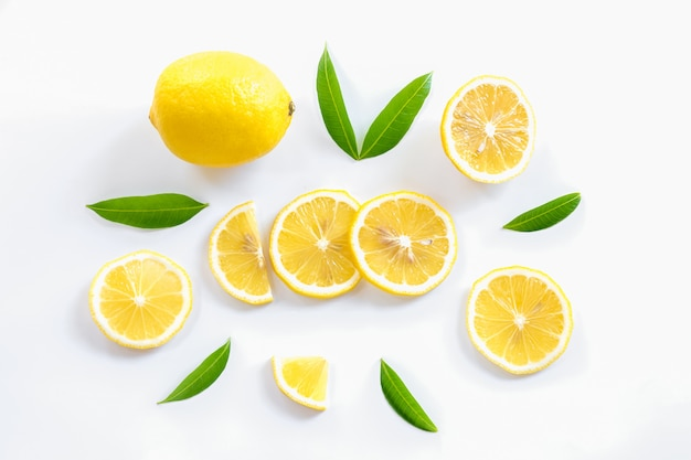 Ripe lemon and slices with leaves