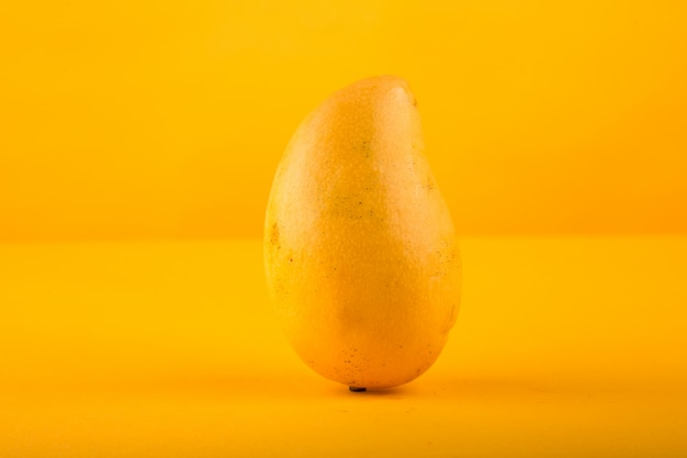 Ripe mango isolated in yellow background