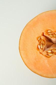 Ripe melon on white background, close up