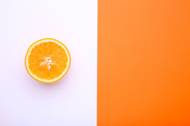 Ripe orange fruit on a colorful background