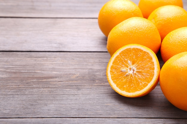 Ripe orange fruit on a grey background