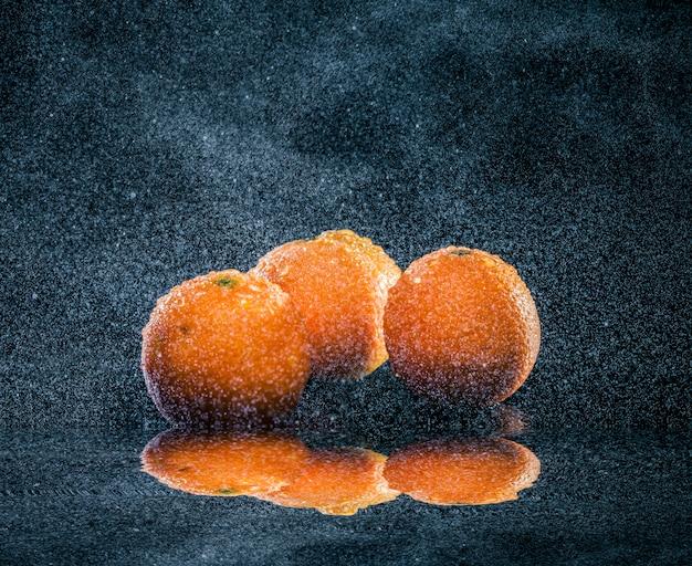 Ripe oranges in water