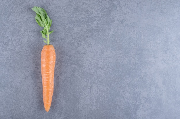 Ripe organic carrots , on the marble surface.