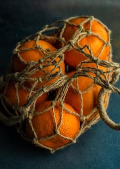 Ripe organic oranges on dark wooden