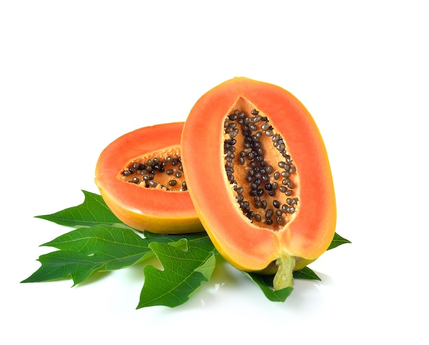 Ripe papaya fruit on white wall