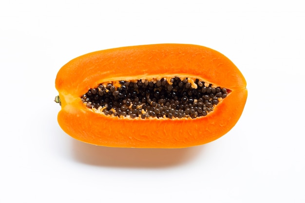 Ripe papaya fruit on white.