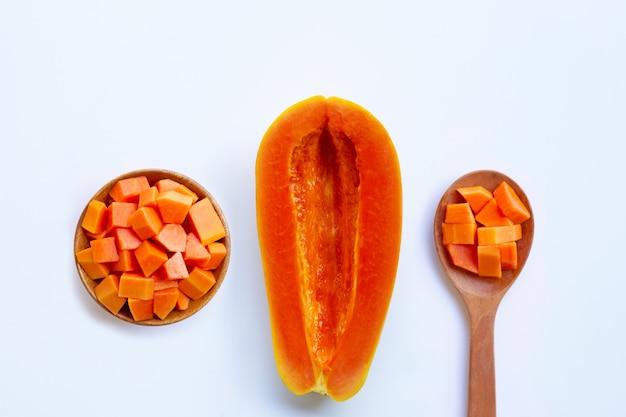 Ripe papaya fruit on white.