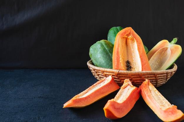 Ripe papaya fruit on wooden back ground