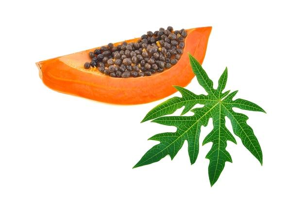 Ripe papaya with leaf on white background