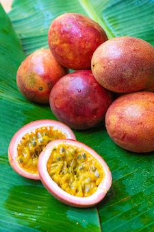 Ripe passion fruit, on a wet banana leaf. vitamins, fruits, healthy foods