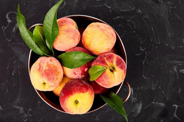 Ripe peaches in a bowl