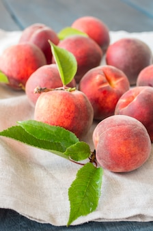 Ripe peaches on a wooden background.