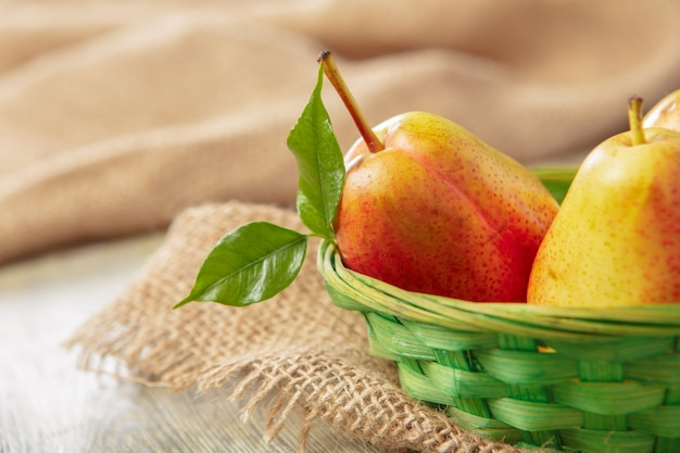 Ripe pears on rustic wooden table