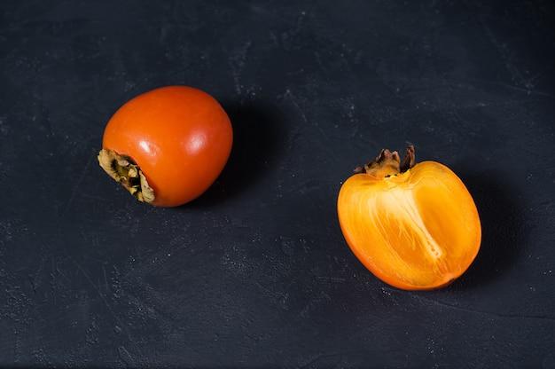 Ripe persimmon on black