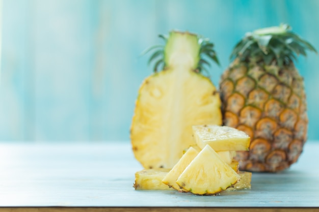 Ripe pineapples summer tropical fruits on pastel turquoise background. summer fruit concept