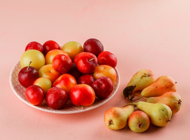 Ripe plums with pears