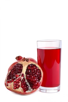 Ripe pomegranate fruit and glass of juice isolated on white background