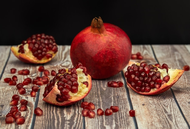 Ripe pomegranate fruit on old brown wooden