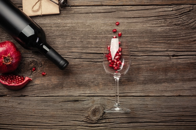 Ripe pomegranate fruit with a glass of wine