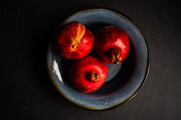 Ripe pomegranate fruits in a bowl