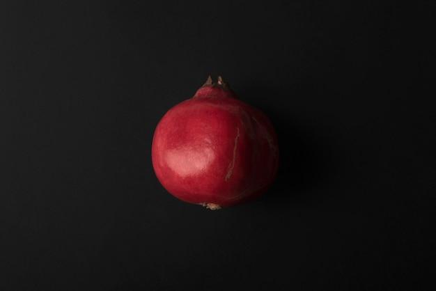 Ripe pomegranate isolated over black