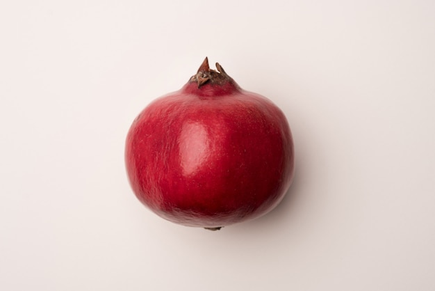Ripe pomegranate isolated over white