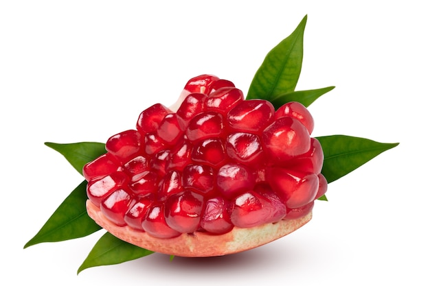 Ripe pomegranate piece with leaves on the white background. with clipping path.
