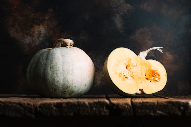 Ripe pumpkins on a wooden table