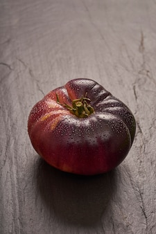 Ripe raf tomato on black slate