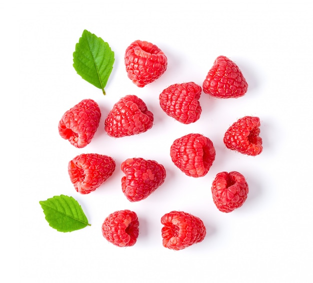 Ripe raspberries on white table.