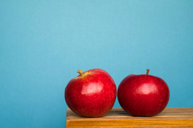 Ripe red apples on table