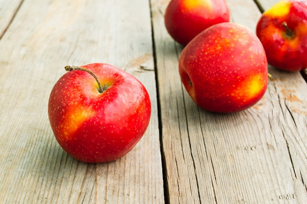 Ripe red apples on a wooden table. rustic style