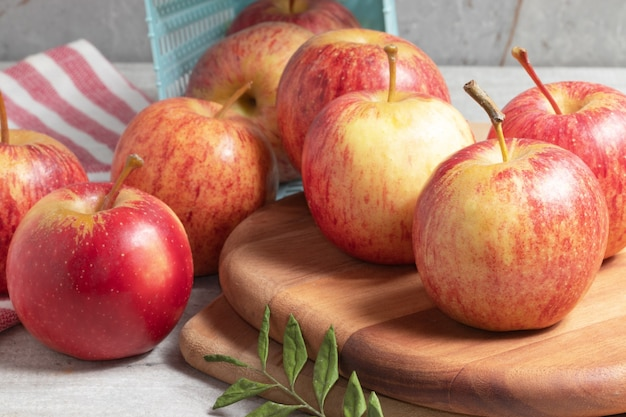 Ripe red apples on wooden table.
