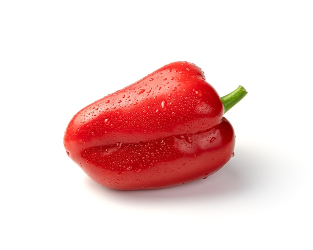 Ripe red bell pepper covered with water drops isolated on a white background. side view.