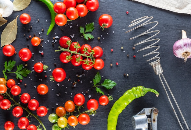 Ripe red cherry tomatoes, chili and spices