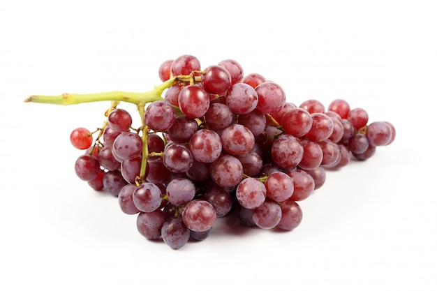 Ripe red grape on a white