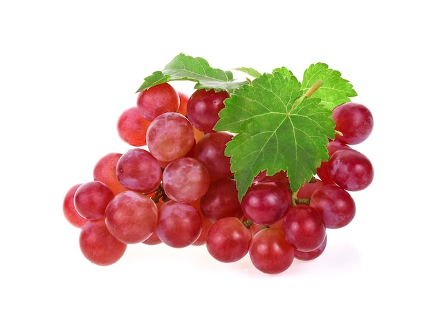 Ripe red grape with leaves on white background